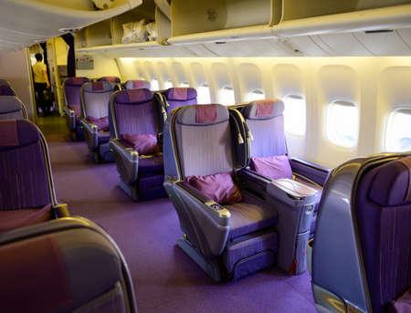 Airplane cabin business class interior Stock Photo