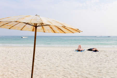 Umbrella on a perfect white sand beach Stok Fotoğraf