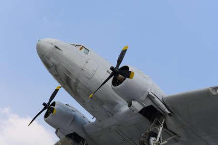 Old military propeller airplane with blue sky