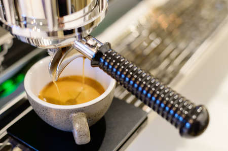 Coffee machine with stream coffee pouring in the cup Stok Fotoğraf