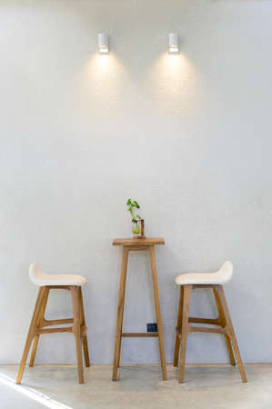 Empty wooden table with two stools Stok Fotoğraf