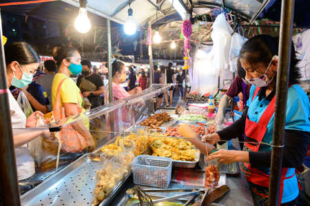 Bangkok, Thailand - April 28, 2020 : Thai people buy food during the lockdown due to Covid-19 virus outbreak