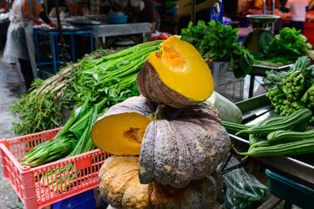 Yellow pumpkin with vegetable on a market at Bangkok Фото со стока