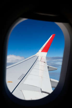 View from airplane porthole on passenger seat