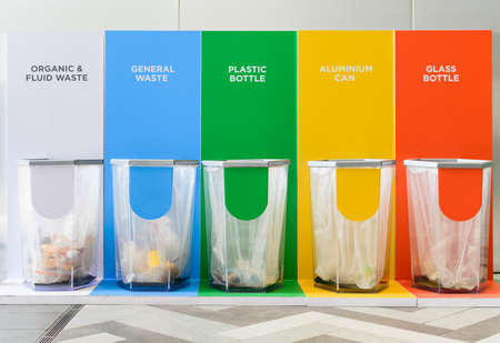Different colored bins for collection of recycle materials Imagens