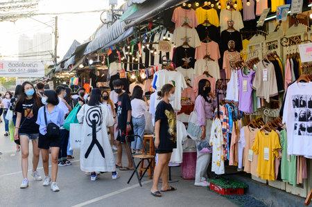 Bangkok, Thailand - January 30, 2021 : Shoppers wear face masks walk at Chatuchak market