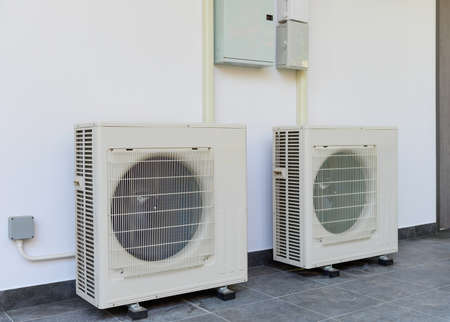 Air conditioning compressor outdoor unit installation of the building side wall
