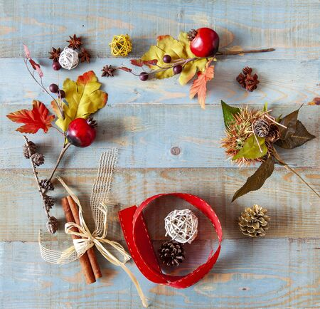 background with autumn leaves with heart shape laid on a dark blue background, also useful image for a Christmas style Stock Photo