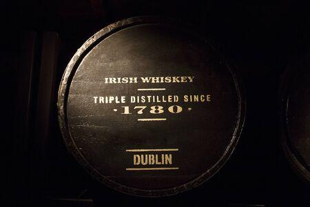 Old wooden barrel full of Dublin's Irish whiskey