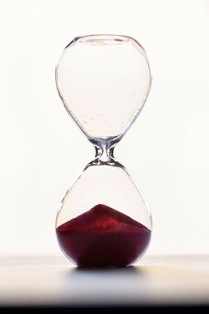 hourglass with red sand and backlight