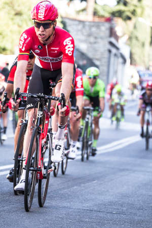 Imperia, IM, Liguria, Italy - March 20, 2016: An important cycling race in a small town in Italy in March. The name of the competition is Milano-Sanremo 2016