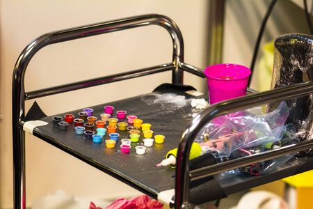 Colors and tools used for tattooing, ink and needles sterilized instruments.