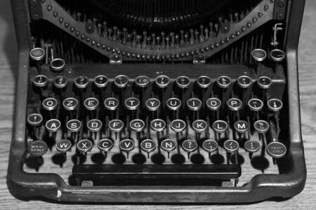 Old typewriter photographed from the front, you see the letter keys.