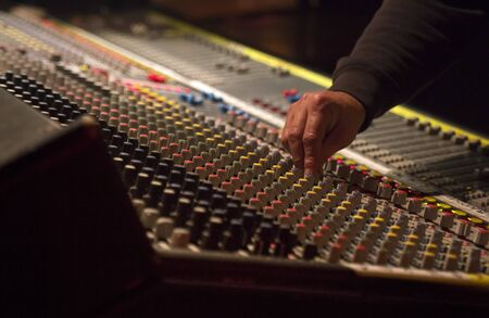 The sound engineer to work with a mixer panel Banco de Imagens