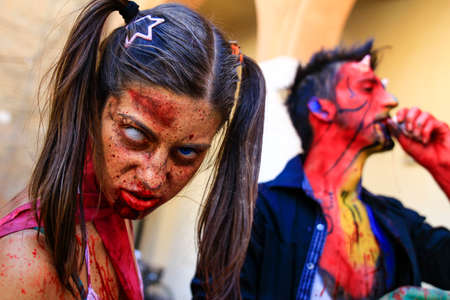 Ferrara, Italy, 16/09/2017: Funny cosplay dressed as Zombie and  devil, photographed during a carnival