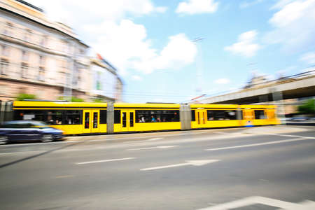 Yellow tram whizzes at high speed in the city of Budapest Stockfoto - 151085507