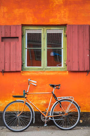 Orange wall and vintage bicycle windows in Copenhagen City