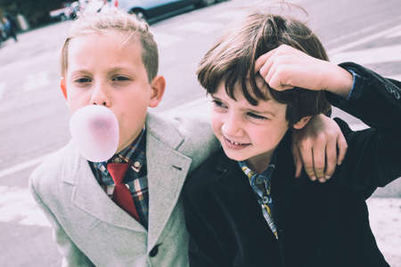 Imperia, Italy, 25/05/2019: Street photography of boys around the city of Imperia photographed while eating chewing gum