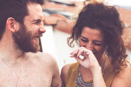 Imperia Italy, 30/06/2019: Man and woman laugh smiles in friendship during a party among friends