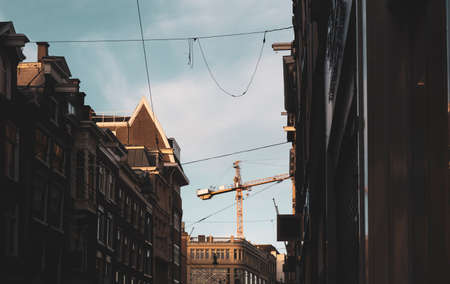 Amsterdam urban landscape with crane used for building construction