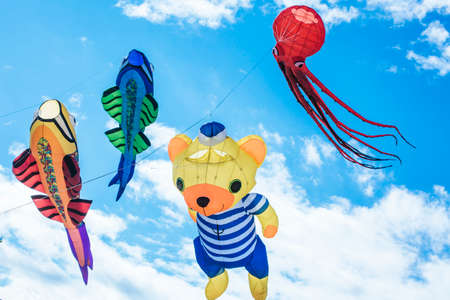 Flying kite with the shape of sea and Fantastic characters.