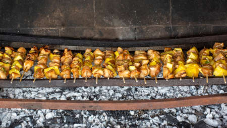 Skewers there meat with pineapple cooked on the grill