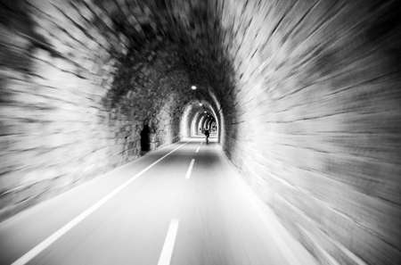 inside a gallery with moving cyclist and Panning photo effect - black and white photos.