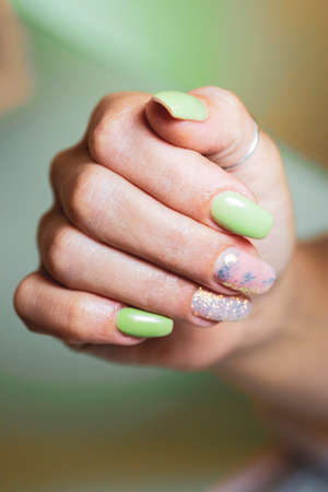 Woman's hands with nails decorated with bright glitter Zdjęcie Seryjne