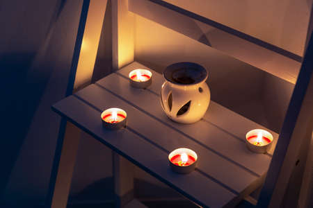 Spa candles and dim lights create a relaxing mood