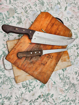 wooden chopping board with kitchen knives