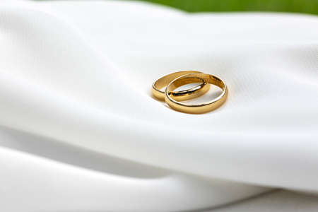 wedding rings on white fabric