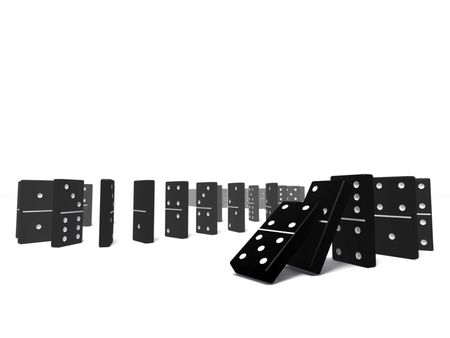 An isolated black domino blocks chain reaction on white background Stock Photo