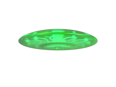 An isolated green ufo hovering on white background Stock Photo