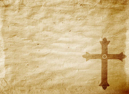 A medieval cross on a worn piece of parchment photo