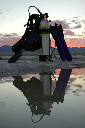 reg: scuba gear all ready to go in the sunset, all labels are universally accepted symbols Stock Photo