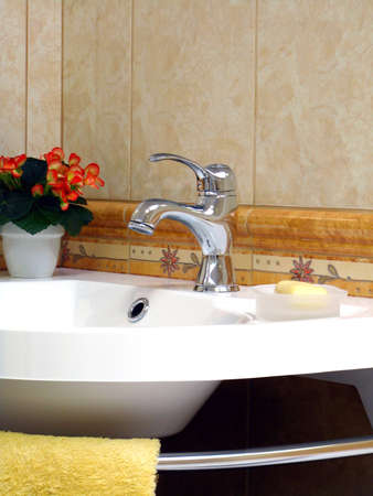 Interior of bathroom - basin and faucet photo