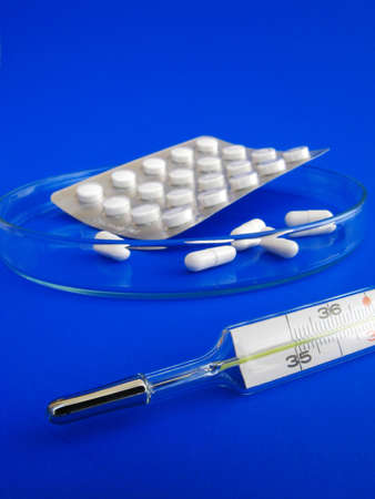 medical pills and thermometer - detail photo