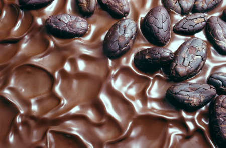 Chocolate icing and cocoa beans photo