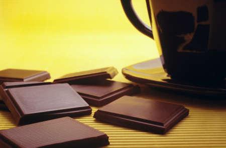 Bar of chocolate and hot chocolate photo