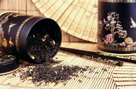 gunpowder tea: Black tea spilling out - still life Stock Photo