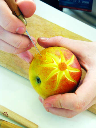 Apple and hands - carving photo