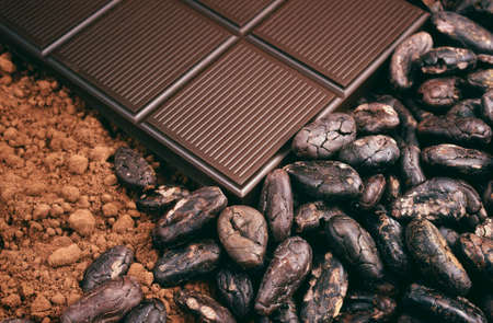 Bar of chocolate, cocoa beans , cocoa powder photo