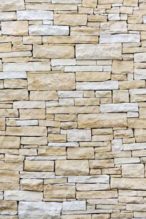 Wall made from sandstone bricks photo