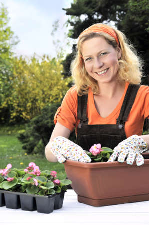 Woman planting flowers Stock Photo - 5604403