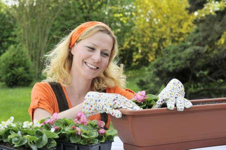Woman planting flowers Stock Photo - 5604426