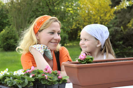 Mother and daughter having gardening time photo