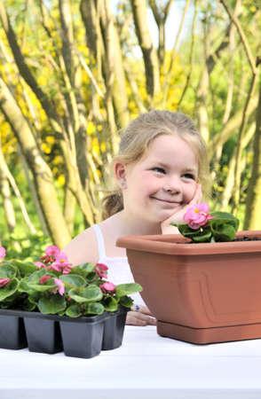 floriculturist: Little girl - gardening