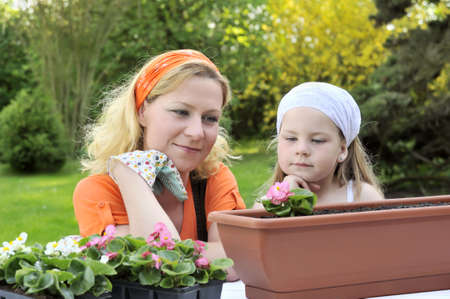 transplants: Mother and daughter having gardening time