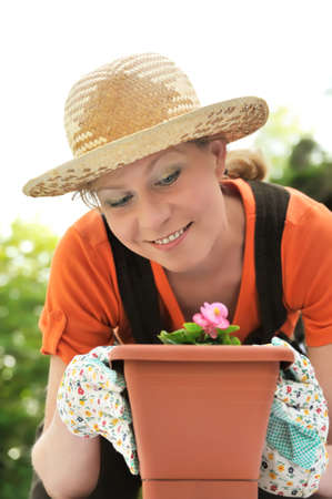 boater: Young woman - gardening Stock Photo