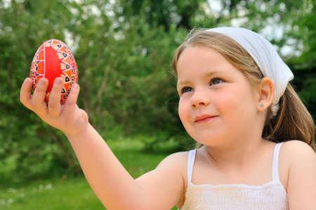Little girl holding Easter egg photo